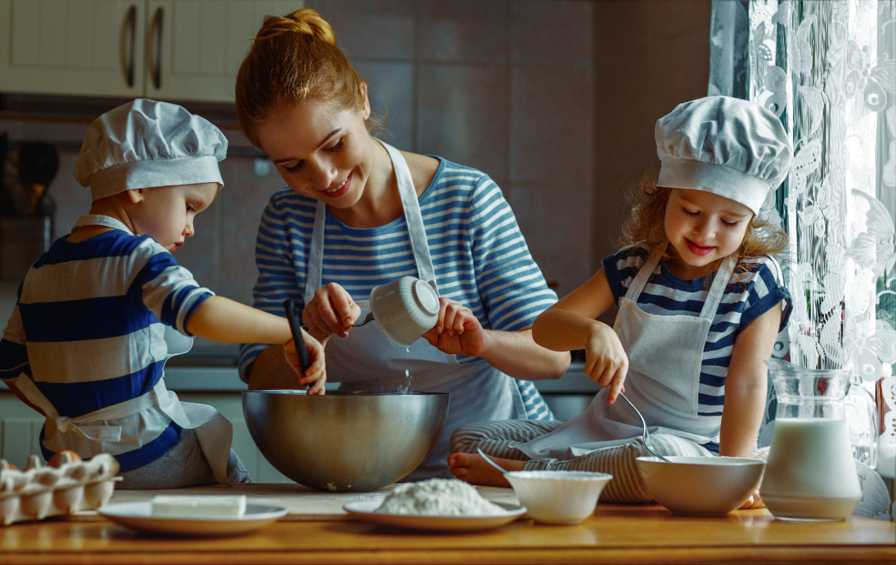 mom teaching kids how to bake